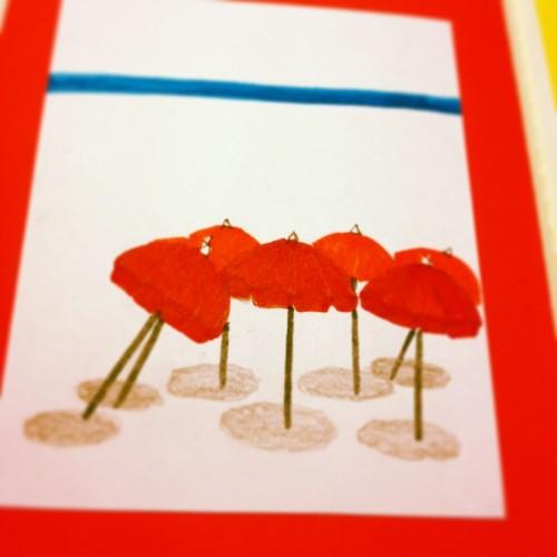 昔描いたイラストをモレスキンに貼付ける。浜辺の赤いパラソル。